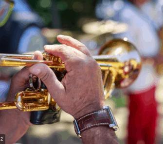 An older man playing a trumpet.