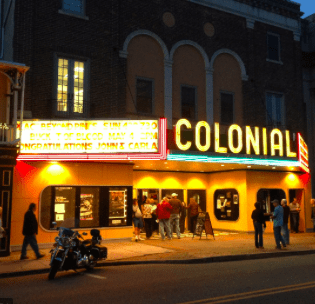 a picture of the outside of the Colonial Theatre at night.
