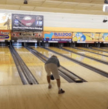 A picture of a person bowling.
