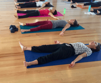 A picture of Keene Yoga Studio with people practicing yoga
