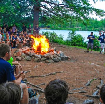 A campfire gathering at Camp Takodah