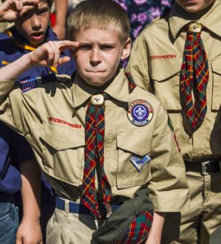 A boy saluting in Boy Scouts