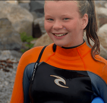 A picture from Big Brothers Big Sisters of a girl surfing