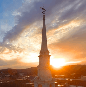 The steeple photographed during a sunset of the United Church of Christ