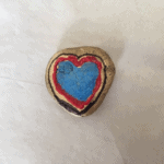 heart parined on a rock