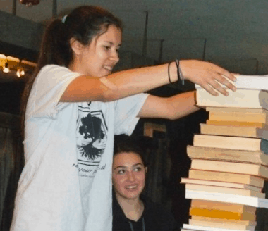 A student stacking books