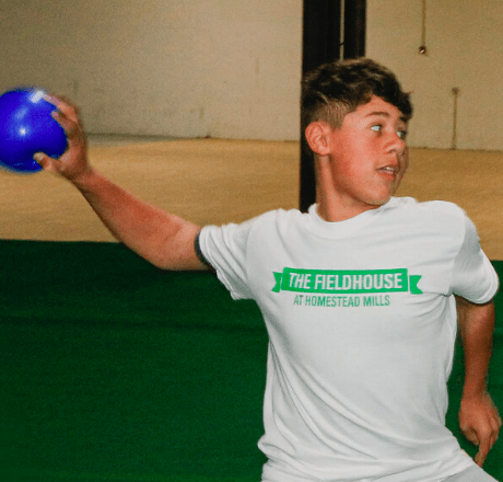 A young man throwing a ball at the sports center