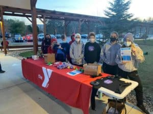The youth group tables outside of the YMCA